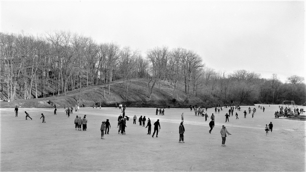 black and white image of skaters on the frozen lake